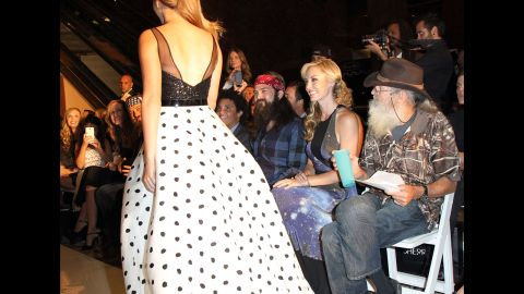 The Robertsons watch as Sadie Robertson, Willie and Korie's daughter, walks in a New York fashion show in September 2013.