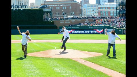 Jase, Si and Willie throw out the ceremonial first pitch before a Major League Baseball game in Detroit in September 2013.