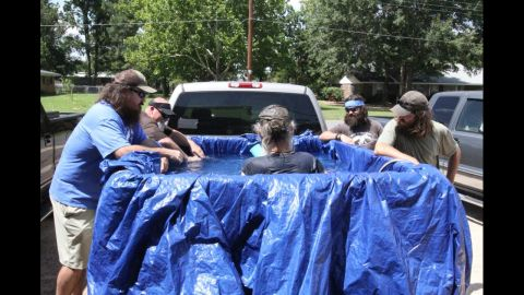 """In a """"Duck Dynasty"""" episode where the office air conditioning broke, Si tries to beat the heat by creating a pool in the back of his pickup truck."""