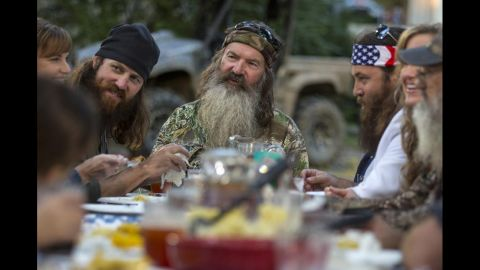 Phil takes his place at the head of the table. A family dinner is the typical scene that ends each episode.