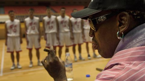 Rodman holds a cigar as he speaks to North Korean basketball players during the practice session in December 2013.