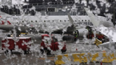 An American Eagle plane waits to be de-iced at Chicago's O'Hare International Airport on Sunday, December 22. The Midwest was battling snowstorms and the South flooding over the weekend, while the Mid-Atlantic states experienced record highs. More extreme weather is expected during the holiday week.