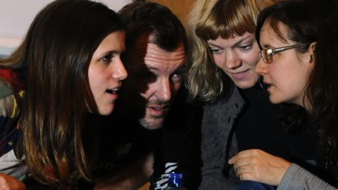 Greenpeace activists, members of the 'Arctic 30,' (from L) Camila Speziale from Argentina, Phil Ball of United Kingdom and Sini Saarela from Finland, attend an informal meeting with local residents in Russia's second city of St. Petersburg, on December 23, 2013.