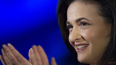 Sheryl Sandberg, chief operating officer of Facebook Inc., reacts during a demonstration at the DreamForce Conference in San Francisco, California, U.S., on Wednesday, Nov. 20, 2013. Salesforce.com Inc. introduced an overhauled version of its mobile software, seeking to ensure clients and partners will be able to use more features of the company's sales, marketing and customer service software.