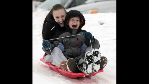 Shannon Abbott of Byron Center, Michigan, and her cousin, P.J. Swainston, slide on the slopes near Dorr, Michigan, on Wednesday, December 25.