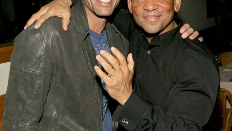 """<a href=""""http://www.cnn.com/2013/12/26/showbiz/celebrity-news-gossip/jeffrey-ian-pollack-obit/index.html"""">Jeffrey Ian Pollack</a>, left, who directed the popular 1990s films """"Booty Call"""" and """"Above the Rim"""" and produced """"The Fresh Prince of Bel-Air,"""" was found dead on December 23. He was 54. He's pictured with producer Benny Medina in 2007."""