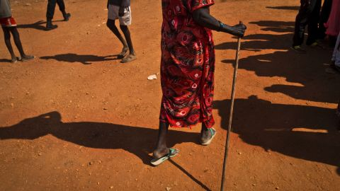 A woman carries items on her head through the U.N. compound in Juba on December 27.