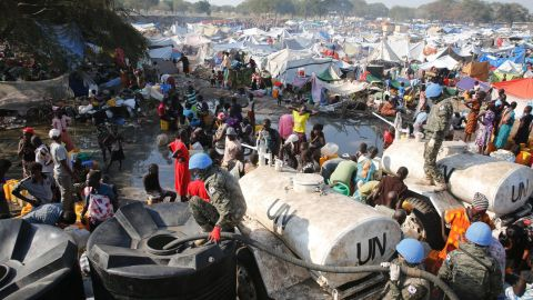 South Korean soldiers provide water at a refugee camp in South Sudan on Thursday, December 26. Hundreds of South Korean soldiers are stationed in the town of Bor as part of United Nations peacekeeping forces.