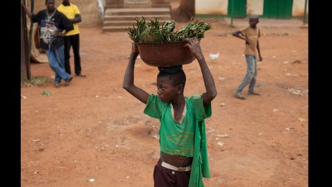 A young boy watches as people hurl rocks at passing vehicles carrying Muslims in the Gobongo neighborhood De