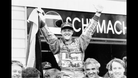 Schumacher is hoisted by his pit crew at the Australian Grand Prix track in Adelaide, Australia, after winning the Formula 1 World Drivers Championship in 1994.