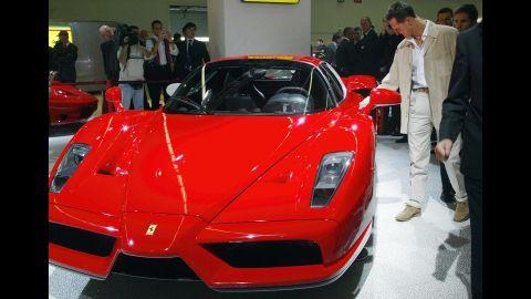 Schumacher checks out an Enzo Ferrari at Frankfurt's International Motor Show in 2003.