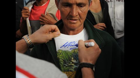 Schumacher autographs the T-shirt of an earthquake victim in Costa Rica in 2009.
