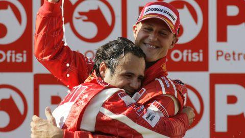 Felipe Massa hugs Schumacher after Massa won first place in the Formula 1 Grand Prix of Turkey in Istanbul in 2006.