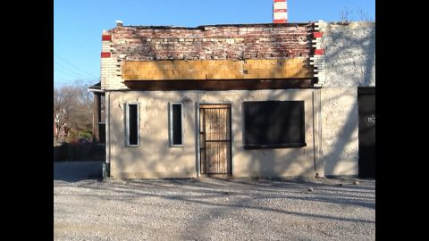 """The vacant gas station was located in a neighborhood of St. Louis that had fallen on hard times. After Poremba opened Olio and neighboring restaurant Elaia,  customers began moving into homes nearby. """"The restaurant didn't alone change the neighborhood -- the people that came to visit the restaurant changed the neighborhood,' he said."""