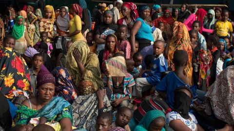 People wait for evacuation flights in a hangar at the airport in Bangui on Sunday, December 29.