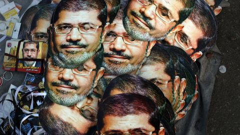 Mohamed Morsy masks are displayed for sale at the base for supporters of the ousted president on July 12, 2013 in Cairo, Egypt. The country has been in a state of political paralysis following the ousting of former president and Muslim Brotherhood leader Morsy by the military.