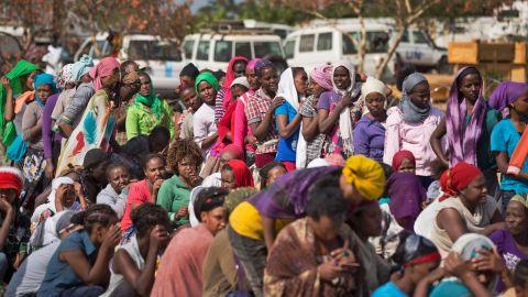 Displaced women wait in line inside a U.N. camp in Malakal on December 30.