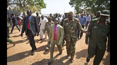 South Sudan Vice President James Wani Igga, center left, arrives to visit patients at the Juba Military Hospital on December 28.