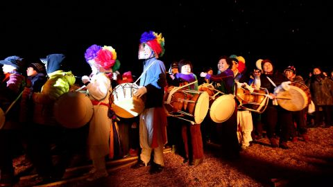 South Koreans celebrate with drums during a New Year's festival in Jeju, South Korea.