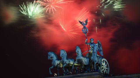Fireworks explode over the landmark Brandenburg Gate to bring in the new year in Berlin on Wednesday, January 1.