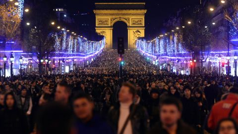 People celebrate the new year on the Champs-Elysees in Paris.