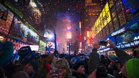 Revelers cheer under falling confetti at the stroke of midnight during New Year's Eve celebrations in Times Square, New York City, just after midnight on January 1.