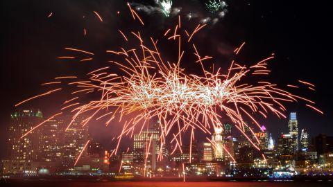 Fireworks explode above the Philadelphia, Pennsylvania, skyline as part of New Year's celebrations on January 1.