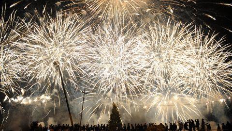 Fireworks explode near the citadel of Arbil during New Year's Eve celebrations in Irbil, Iraqi Kurdish Regional Administration, on January 1.