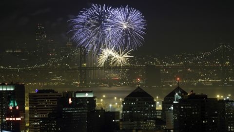 Fireworks fill the air over the San Francisco skyline, near the San Francisco Oakland Bay Bridge, as part of New Year's Eve celebrations just after midnight on Wednesday, January 1. Click through to see other New Year's celebrations around the world: