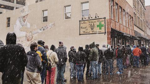 People line up to buy recreational marijuana at the LoDo Wellness Center.