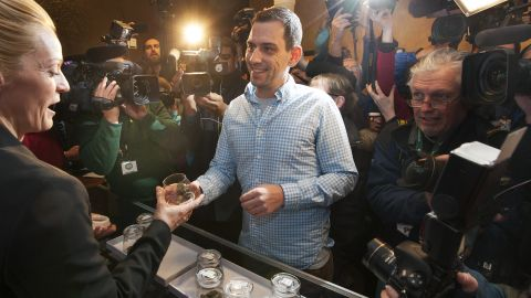 """Sean Azzariti, an Iraq war veteran and marijuana activist, becomes the first person to legally purchase recreational marijuana in Colorado on January 1, 2014. Colorado was the first state in the nation to allow retail pot shops. """"It's huge,"""" Azzariti said. """"It hasn't even sunk in how big this is yet."""""""