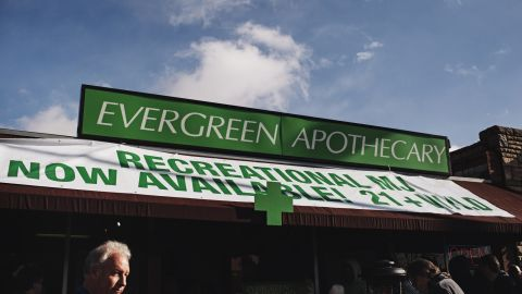 People line up to buy recreational marijuana outside of Evergreen Apothecary.