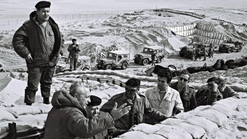 Former Prime Minister David Ben-Gurion is briefed in 1971 by Sharon in a trench near the Suez Canal in the Sinai.<br />