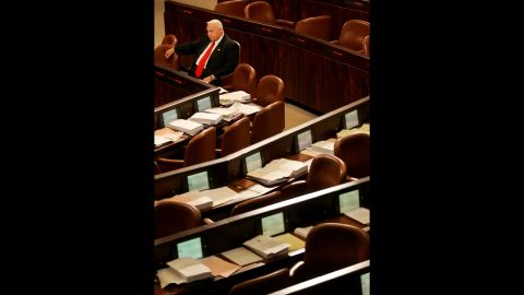 Sharon sits alone as he waits for other Knesset members to arrive for a vote on March 28, 2005. Sharon pushed for Israel's historic 2005 withdrawal from 25 settlements in the West Bank and Gaza, which was turned over to Palestinian rule for the first time in 38 years.