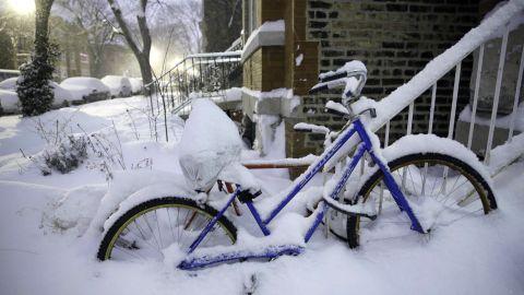 Snow covers bikes along Leavitt Street in Chicago's Wicker Park on January 2.