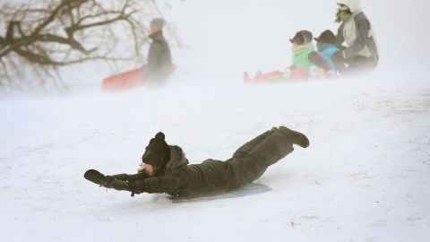 A child sleds down a hill in Chicago's Humboldt Park on Thursday, January 2.