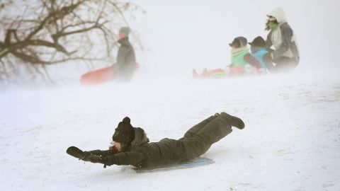 A child slides down a hill on a sled in Chicago's Humboldt Park in January 2014.