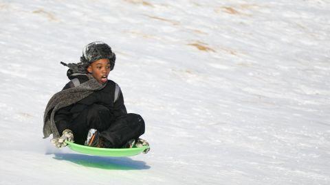 Dallas Todd, 11, flies down a snowy hill at Lake Harbor Park in Norton Shores, Michigan, on January 2.