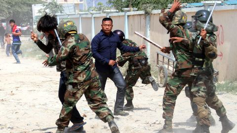 Cambodian soldiers clash with protesters during a rally by garment workers calling for higher wages in front of a factory in Phnom Penh on January 2.
