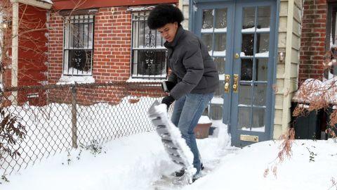 Dante de Blasio, son of New York Mayor Bill de Blasio, shovels snow outside his home in Brooklyn on January 3.