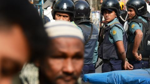 Bangladeshi policemen look on as devotees arrive for Friday prayers at a mosque in Dhaka on January 3, 2014. More than three-quarters of Bangladeshis are opposed to this weekend's general election which is being boycotted by the main opposition, a poll showed Friday. Policemen were deployed throughout the city in anticipation to confront any civil unrest. AFP PHOTO/Roberto SCHMIDTROBERTO SCHMIDT/AFP/Getty Images