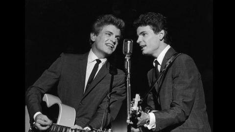 """Singer<a href=""""http://www.cnn.com/2014/01/03/showbiz/singer-phil-everly-dies/index.html?hpt=hp_t1"""" target=""""_blank""""> Phil Everly</a>, left, one half of the groundbreaking, smooth-sounding, record-setting duo the Everly Brothers. has died, a hospital spokeswoman said. He was 74."""