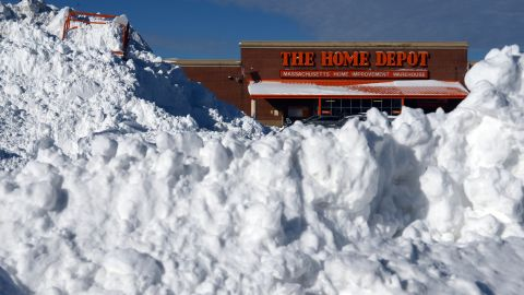 Snow is piled high in front of a Home Depot in Boston on January 4.
