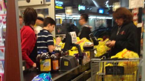 Local New Yorkers rush to grocery stores to prepare for the storm on January 2, 2014.