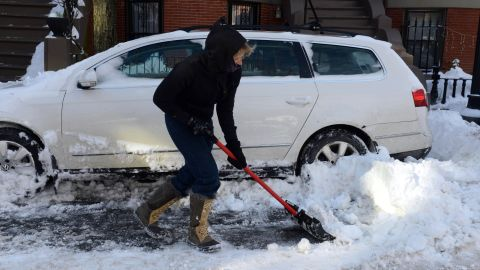 A woman shovels her car out from snow on East Concord Street in the South End after a two day winter storm January 4, 2014 in Boston, Massachusetts.