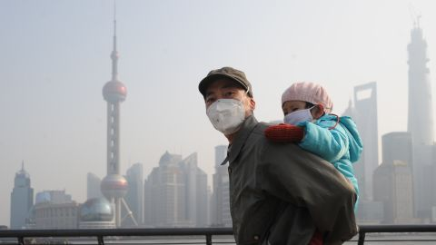 Face masks that protect against the smog are de rigueur for both a morning stroll .....