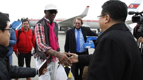 Former NBA star Dennis Rodman shakes hands with North Korea's Sports Ministry Vice Minister Son Kwang Ho upon his arrival at the international airport in Pyongyang on Monday, January 6.