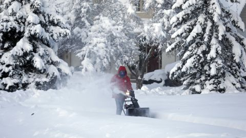 A man clears the sidewalk in front of his home in Carmel, Indiana, on January 6.