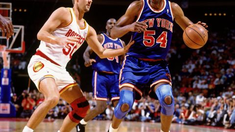 Power forward Charles Smith, dribbling the ball in this photo, played nine NBA seasons after being drafted third overall by the Los Angeles Clippers in 1988. He averaged 14.4 points and 5.8 rebounds during his career.