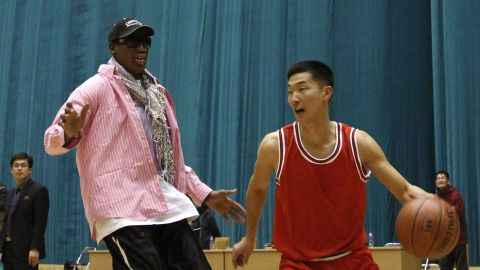 Former NBA basketball star Dennis Rodman plays one-on-one with north Korean player during a basketball practice session in Pyongyang, North Korea on Friday, Dec. 20, 2013. Rodman selected the members of the North Korean team who will play in Pyongyang against visiting NBA stars on Jan. 8, 2014, the birthday of North Korean leader Kim Jong Un. (AP Photo/Kim Kwang Hyon)